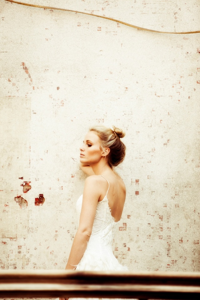 The LANE Bridal Editorial_NYC_Lauren Ross_Shanay Hall_Feather Wedding Dress_High Bun Wedding Hairstyle