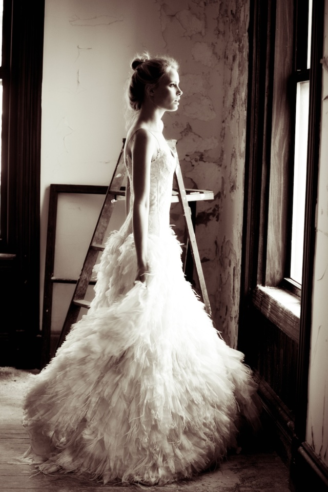 The LANE Bridal Editorial_NYC_Lauren Ross 15_Bride at Window_Feather Monique Lhuillier Gown